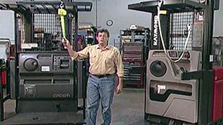 A man instructs viewers on order picker safety rules