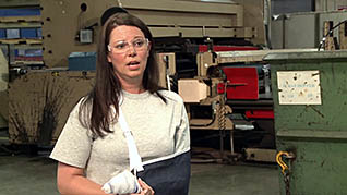 Screenshot of woman in a splint in the cell phone safety in the workplace training video