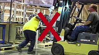 A demonstration of improper forklift use in the forklift safety training video