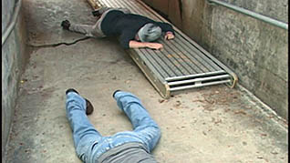 Two workers that have fallen to the ground due to a lack of proper H2S training