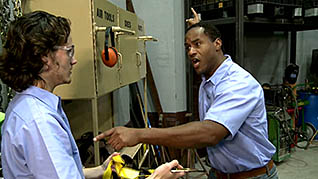 A man talking to a co-worker about safety