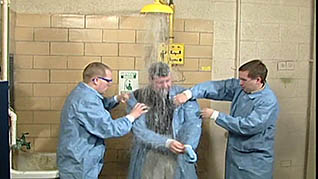 Assisting coworkers using a safety shower