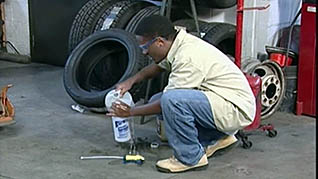 An auto facility worker in the mechanic safety training video