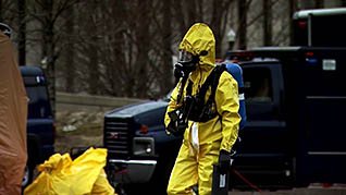 A HAZMAT worker in the HAZMAT shipping papers training video
