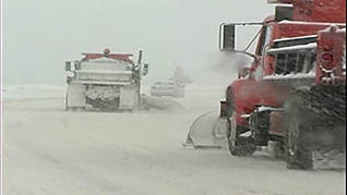 working with several snow removal vehicles